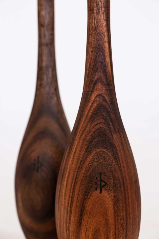 Spalding ES walnut Indian clubs close up